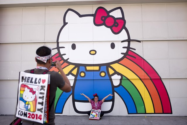 Keith Nunez, left, takes pictures of his wife, Carolina, at the first-ever Hello Kitty fan convention, Hello Kitty Con, held at the Geffen Contemporary at MOCA, Thursday, October 30, 2014, in Los Angeles. (Photo by Jae C. Hong/AP Photo)