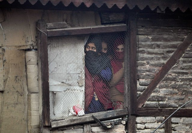 Kashmiri Muslim women watch a a Muharram procession a day before Ashoura in Srinagar November 3, 2014. (Photo by Danish Ismail/Reuters)