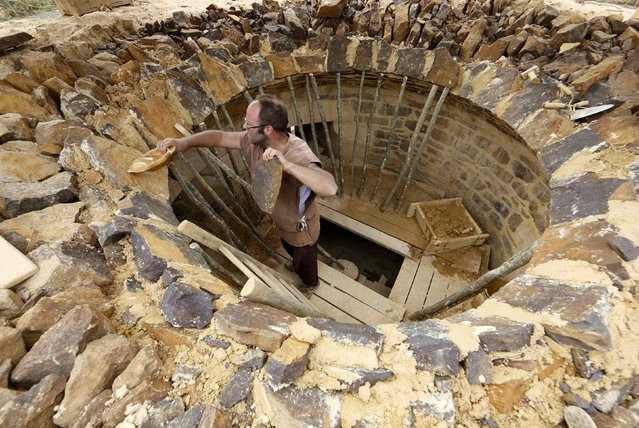 A man works at the construction site of the Chateau de Guedelon near Treigny in the Burgundy region of France, September 13, 2016. (Photo by Jacky Naegelen/Reuters)