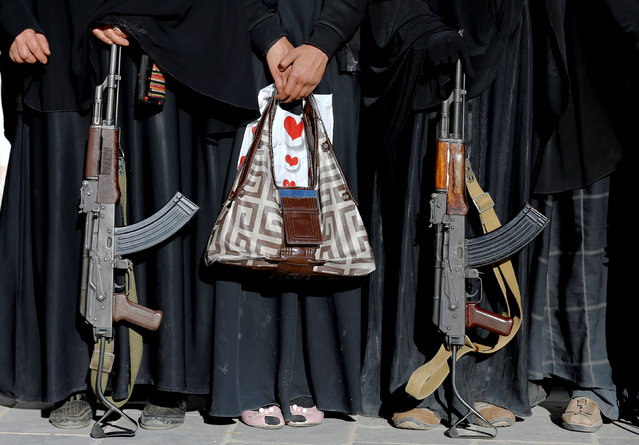 Armed women attend a rally to show support to the Houthi movement in Sanaa, Yemen January 13, 2018. (Photo by Khaled Abdullah/Reuters)