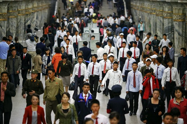 Commuters make their way through a subway station visited by foreign reporters during a government organised tour in Pyongyang, North Korea October 9, 2015. (Photo by Damir Sagolj/Reuters)