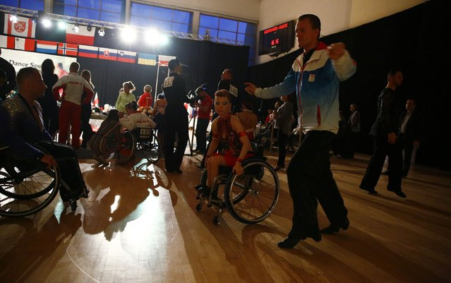 Maria Gazdikova and Maros Olejar of Slovakia practise before their start during IPC Wheelchair Dance Sport European Championships in Lomianki near Warsaw, November 9, 2014. (Photo by Kacper Pempel/Reuters)