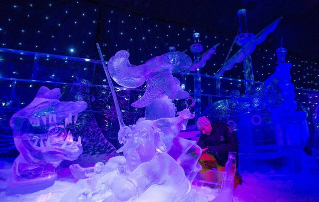 Sculptor Sebastien Dieu of France carves an ice sculpture at the Disney Dreams Ice Festival in Antwerp November 27, 2014. (Photo by Yves Herman/Reuters)