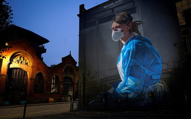 A mural depicting NHS nurse Melanie Senior, based on a photograph by Johannah Churchill, which The National Portrait Gallery commissioned artist Peter Barber to create in Manchester's Northern Quarter, on October 19, 2020 in Manchester, England. Greater Manchester's leaders including Mayor Andy Burnham will want better financial arrangements for workers affected before they agree for the region to be moved into a Tier 3 Covid-19 lockdown. (Photo by Christopher Furlong/Getty Images)