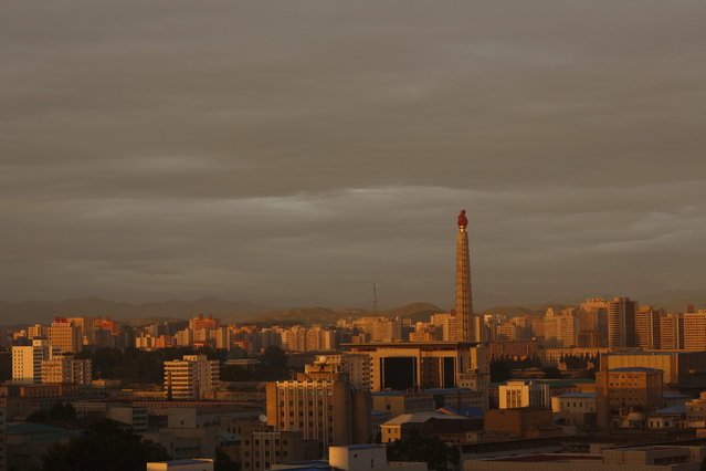 In this September 17, 2012 photo, the sun sets over the tower of the Juche Idea in Pyongyang, North Korea. (Photo by Vincent Yu/AP Photo)