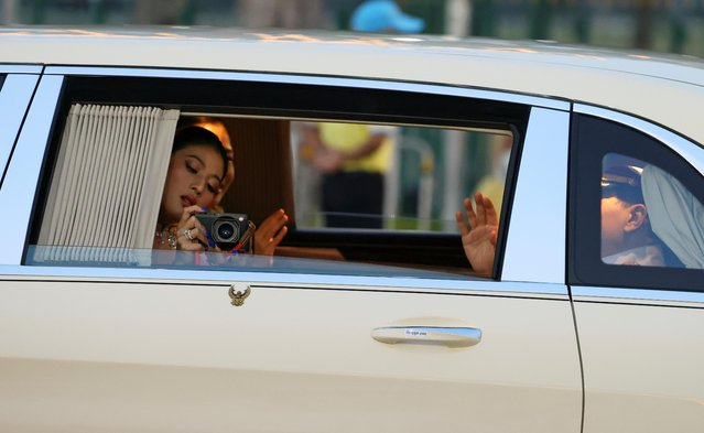 Thailand's Princess Sirivannavari Nariratana takes pictures as she arrives before a religion ceremony to commemorate the death of King Chulalongkorn, known as King Rama V at The Grand Palace in Bangkok, Thailand, October 23, 2020. Thailand has been rocked by months of anti-government demonstrations that have increasingly called for reforms of the monarchy, breaking a longstanding taboo and defying a law that sets a jail term of up to 15 years for criticizing the king and his family. (Photo by Athit Perawongmetha/Reuters)