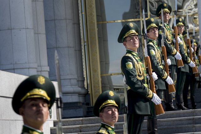 Presidential Guards wait during a meeting between U.S. Secretary of State John Kerry and Turkmen President Gurbanguly Berdimuhamedov at the Oguzkhan Presidential Palace on November 3, 2015 in Ashgabat. Kerry is travelling to Tajikistan and Turkmenistan on the last day of his travels in the region as he visits five Central Asian nations. (Photo by Brendan Smialowski/Reuters)