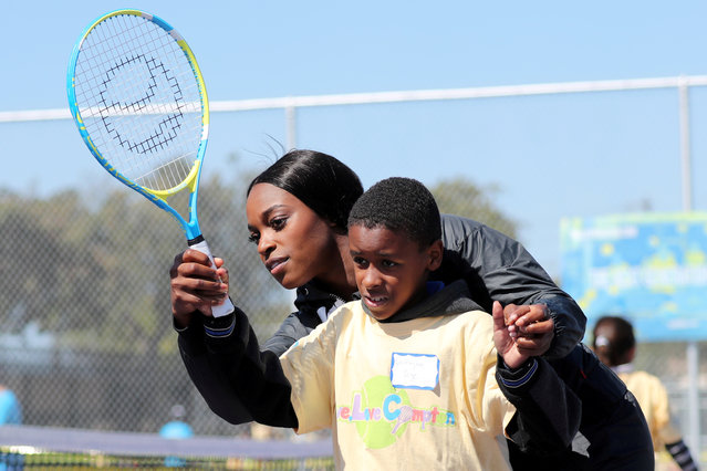 U.S. Open Champion Sloane Stephens teaches tennis to 400 elementary students at a workshop in Compton, California on April 13, 2018. (Photo by Lucy Nicholson/Reuters)