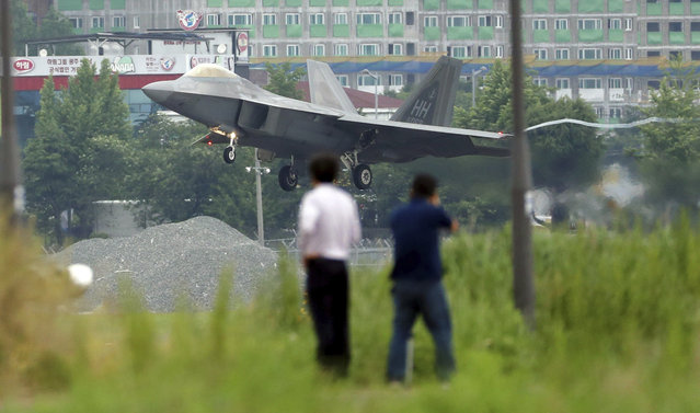 A U.S. F-22 Raptor stealth fighter jet lands as South Korea and the United States conduct the Max Thunder joint military exercise at an air base in Gwangju, South Korea, Wednesday, May 16, 2018. North Korea on Wednesday canceled a high-level meeting with South Korea and threatened to scrap a historic summit next month between President Donald Trump and North Korean leader Kim Jong Un over military exercises between Seoul and Washington that Pyongyang has long claimed are invasion rehearsals. (Photo by Park Chul-hog/Yonhap via AP Photo)
