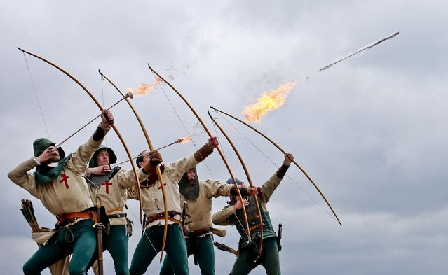 Purbrook Bowmen fire a volley of flaming arrows from Southsea Castle as part of a day of events to mark the opening of the Mary Rose Museum in Portsmouth, England, on May 30, 2013. (Photo by Peter Macdiarmid/Getty Images)