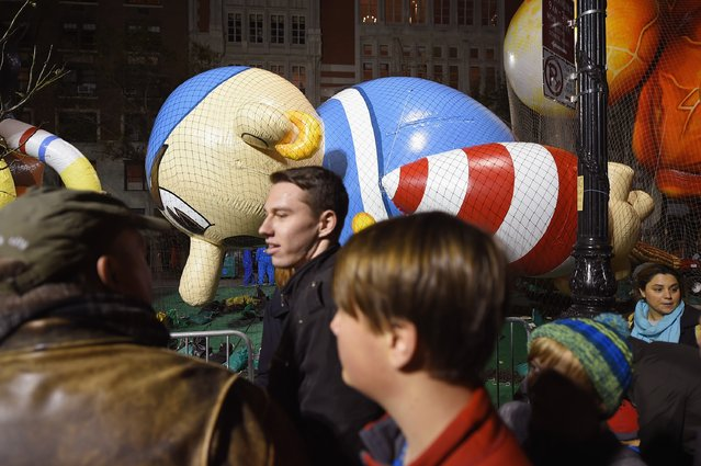 General view of onlookers passing the Arrtle the Pirate balloon during the 89th Annual Macy's Thanksgiving Day Inflation Eve on November 25, 2015 in New York City. (Photo by Michael Loccisano/Getty Images)