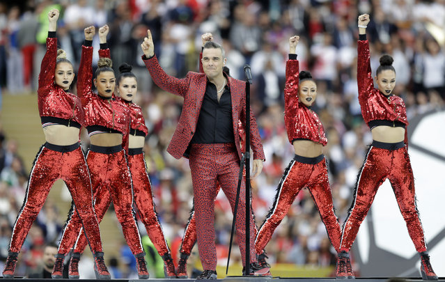 British singer Robbie Williams performs before the group A match between Russia and Saudi Arabia which opens the 2018 soccer World Cup at the Luzhniki stadium in Moscow, Russia, Thursday, June 14, 2018. (Photo by Matthias Schrader/AP Photo)