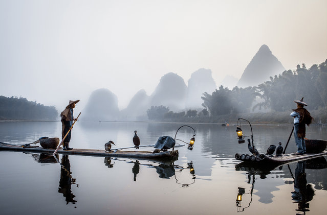 """Fishermans in the fog"". Cormorans fisherman on the Li river, Yangshuo – China. (Photo and caption by Philippe Cap/National Geographic Traveler Photo Contest)"