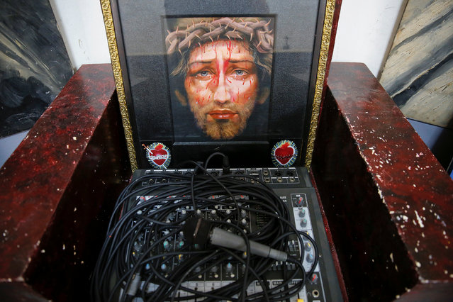 A religious picture is placed next to a microphone and sound system at the chapel of Quezon City Jail in Manila, Philippines October 19, 2016. (Photo by Damir Sagolj/Reuters)