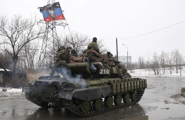 Members of the armed forces of the separatist self-proclaimed Donetsk People's Republic drive an armoured vehicle on the outskirts of Donetsk January 22, 2015. (Photo by Alexander Ermochenko/Reuters)