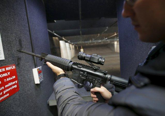 Alec Murrary holds an AR-15 assault rifle at the Ringmasters of Utah gun range, in Springville, Utah on December 18, 2015. (Photo by George Frey/Reuters)
