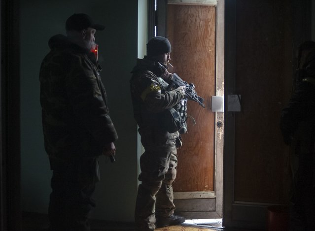 Members of the Ukrainian armed forces gather inside a school building in Debaltseve, Donetsk region, January 30, 2015. (Photo by Maksim Levin/Reuters)