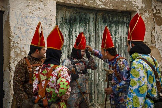 "Members of the Endiablada brotherhood joke during the ""Endiablada"" traditional festival in Almonacid Del Marquesado, Spain, Tuesday, February 3, 2015. (Photo by Daniel Ochoa de Olza/AP Photo)"