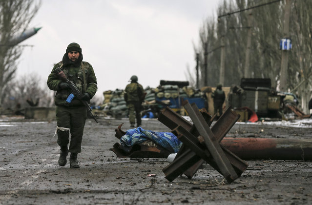 Members of the armed forces of the separatist self-proclaimed Donetsk People's Republic gather at a checkpoint in Vuhlehirsk, Donetsk region, February 4, 2015. (Photo by Maxim Shemetov/Reuters)