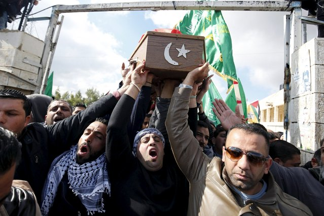 Mourners carry the body of Palestinian woman Mahdia Hamad, 38, during her funeral in Silwad near the West Bank city of Ramallah December 26, 2015. Israeli border police shot dead Hamad who tried to ram them with her car in the West Bank on Friday, the police said. Palestinian witness said the police opened fire when the car was 150 metres away from them. (Photo by Mohamad Torokman/Reuters)