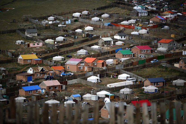 Gers, traditional Mongolian tents, are seen on a hill in an area known as a ger district in Ulan Bator June 22, 2013. Approximately 60 percent of the population of Ulan Bator live in settlements known as ger districts and in many cases residents have limited access to basic services such as water and sanitation. According to a 2010 National Population Center census, every year between thirty and forty thousand people migrate from the countryside to the capital Ulan Bator. Ger districts in the city have been expanding rapidly in recent years. Mongolia is the world's least densely populated country, with 2.8 million people spread across an area around three times the size of France. (Photo by Carlos Barria/Reuters)