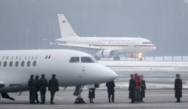 Aircrafts, carrying Germany's Chancellor Angela Merkel (back) and France's President Francois Hollande, are seen upon the arrival at an airport near Minsk, February 11, 2015. (Photo by Maxim Shipenkov/Reuters)