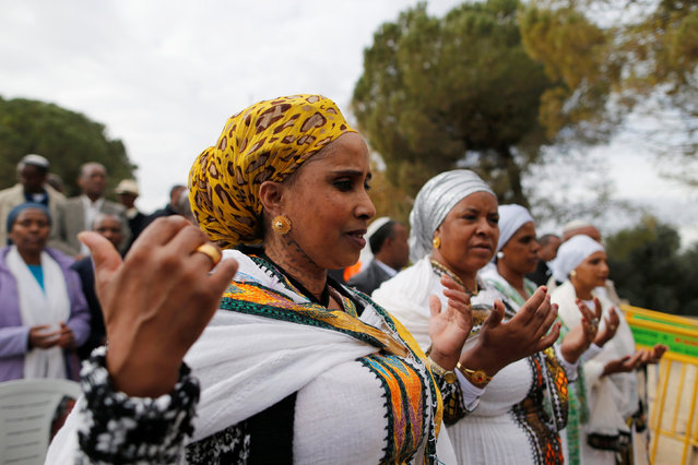 Members of the Israeli Ethiopian community pray during a ceremony marking the Ethiopian Jewish holiday of Sigd in Jerusalem November 30, 2016. (Photo by Ammar Awad/Reuters)