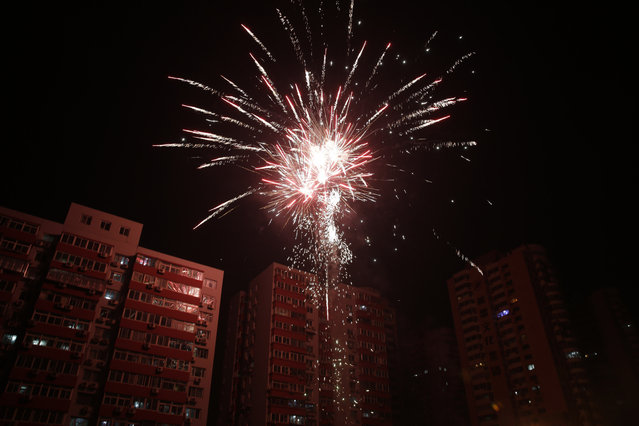 Fireworks light up a residential apartments during the Chinese New Year's Eve in Beijing Wednesday, February 19, 2015. (Photo by Andy Wong/AP Photo)