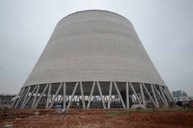 A view of the site where a power plant's cooling tower under construction collapsed in Fengcheng, Jiangxi province, China, November 24, 2016. (Photo by Reuters/China Daily)