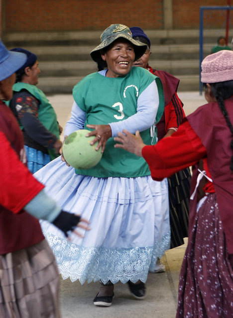 """In this February 11, 2105 photo, 78-year-old Genara Quispe plays handball with other Aymara indigenous elderly women in El Alto, Bolivia. """"This sport makes me feel alive and that I can still run around"""", Quispe said. (Photo by Juan Karita/AP Photo)"""