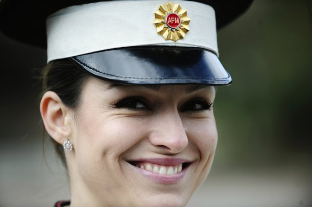 Corporal Dragana Kitanovska smiles during an honour guard training session at an army barracks in Skopje March 4, 2015. Macedonia's honour army battalion, the ceremonial uniformed guard that receives every foreign president, dignitaries and delegations, but also sees off and welcomes the head of state every time he leaves the country, has a different glow. For the first time in the history of Macedonia's army, the honour guard has two women in its ranks. There has not been an event in which one of them is not in the first row. Verica Zlatevska joined the army in 2003, Kitanovska in 2006. Picture taken March 4, 2015.   REUTERS/Ognen Teofilovski (MACEDONIA  - Tags: MILITARY SOCIETY)