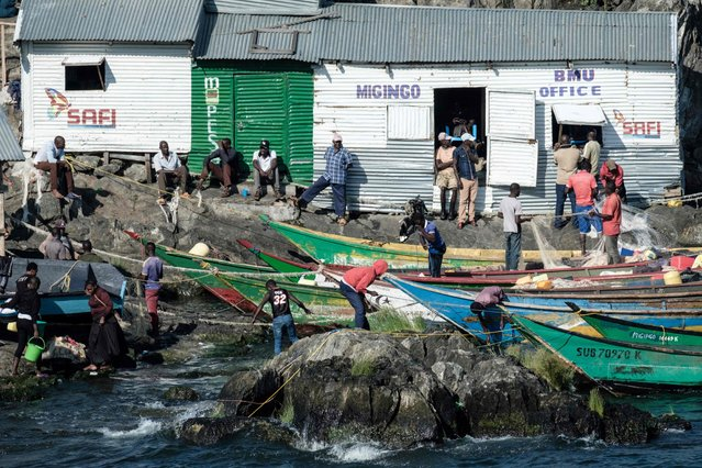 A picture taken on October 5, 2018, shows a general view of Migingo island which is densely populated by residents fishing mainly for Nile perch in Lake Victoria on the border of Uganda and Kenya. (Photo by Yasuyoshi Chiba/AFP Photo)