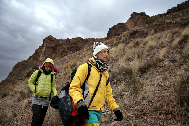 In this Tuesday, January 19, 2016 photo, Iranian rock climber, Farnaz Esmaeilzadeh, center, approaches cliffs in a mountainous area outside the city of Zanjan, some 330 kilometers (207 miles) west of the capital Tehran, Iran. (Photo by Ebrahim Noroozi/AP Photo)