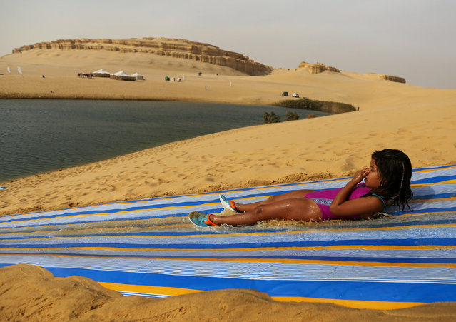 EGYPT: A girl slides down a ramp into the lake in Wadi el-Rayan Fayoum, Egypt, November 18, 2016. (Photo by Mohamed Abd El Ghany/Reuters)