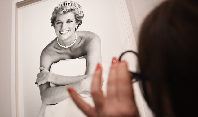 "An image of Princess Diana is inspected at the press preview for ""Vogue 100: A Century of Style"" exhibiting the photographs that has been commissioned by British Vogue since it was founded in 1916 at National Portrait Gallery on February 10, 2016 in London, England. (Photo by Stuart C. Wilson/Getty Images)"