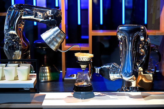 Robotic arms make coffee in a demostration using a pair of VS-S2 Series robots at the Denso booth at CES 2017 at the Las Vegas Convention Center on January 5, 2017 in Las Vegas, Nevada. (Photo by David Becker/Getty Images)