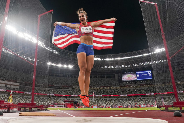 Valarie Allman, of the United States, celebrates after winning the gold medal in the women's discus throw final at the 2020 Summer Olympics, Monday, August 2, 2021, in Tokyo. (Photo by David J. Phillip/AP Photo)