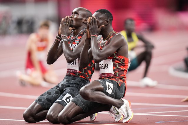 Kenyans Emmanuel Kipkurui Korir, right, and Ferguson Cheruiyot Rotich finish first and second, respectively, in the 800m final during the Tokyo 2020 Olympic Games at the Olympic Stadium in Tokyo on August 4, 2021. (Photo by Toni L. Sandys/The Washington Post)