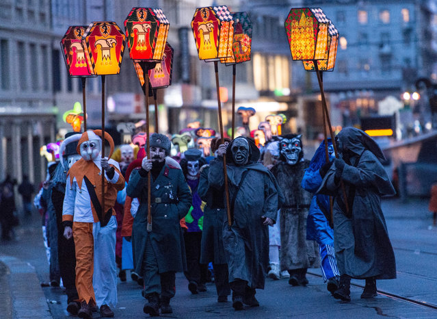 Revellers wearing lanterns parade through the streets during the carnival procession of Basel, Switzerland, 15 February 2016. The traditional Morgestraich starting Monday morning after Ash Wednesday at 4 a.m. marks the kick-off of the Carnival of Basel. (Photo by Patrick Seeger/EPA)