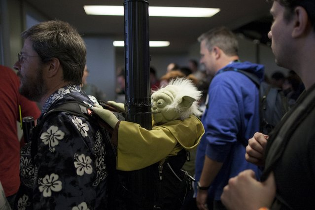 Fans exit the hall after the kick-off event of the Star Wars Celebration convention in Anaheim, California, April 16, 2015. (Photo by David McNew/Reuters)