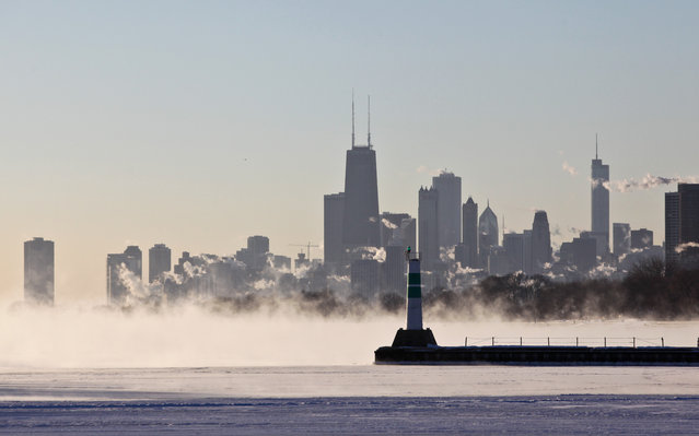 """A blanket of fog covers Lake Michigan along the Chicago shoreline Monday, January 6, 2014 as temperatures dove well below zero and wind chills were expected to reach 40 to 50 below.  A whirlpool of frigid, dense air known as a """"polar vortex"""" descended Monday into much of the U.S. (Photo by Teresa Crawford/AP Photo)"""