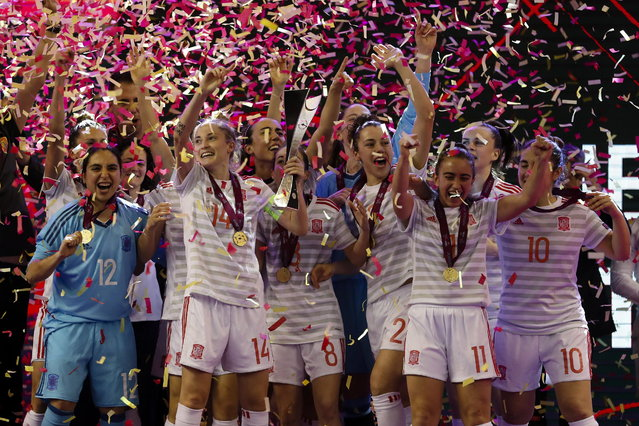 Spain national team players celebrate with the trophy after winning their UEFA Women's Futsal Euro Final match against Portugal, held at Multiusos de Gondomar Pavillion in Gondomar, Porto, northern Portugal, 17 February 2019. (Photo by Jose Coelho/EPA/EFE)