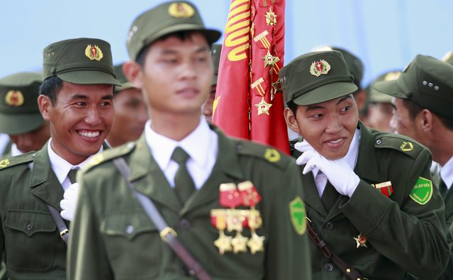 Vietnamese village policemen joke during a rehearsal for a military parade as part of the 40th anniversary of the fall of Saigon in southern Ho Chi Minh City (formerly Saigon City), Vietnam, on April 26, 2015. (Photo by Reuters/Kham)