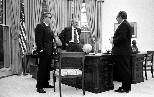 In this April 28, 1975 photo provided the White House via the Gerald R. Ford Library, President Gerald Ford, center, meets with Secretary of State Henry Kissinger, right, and Vice President Nelson Rockefeller in the Oval Office of the White House to discuss the American evacuation of Saigon. (Photo by David Hume Kennerly/White House, Gerald R. Ford Library via AP Photo)
