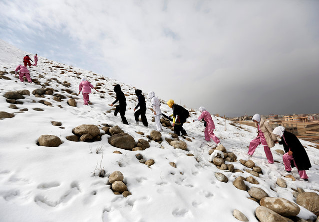 Students of the Shaolin Wushu club climb a hill as they arrive to practice in Kabul, Afghanistan January 29, 2017. (Photo by Mohammad Ismail/Reuters)
