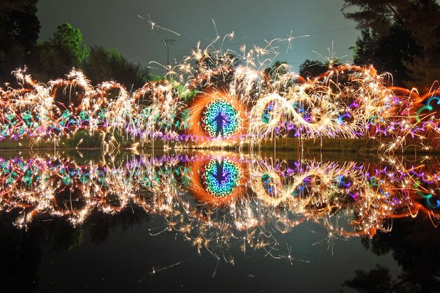 An artist has used the great outdoors as his canvas – painting spectacular scenes by using nothing except lights. (Photo by Caters News)