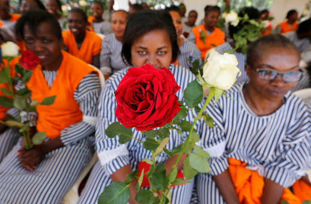 """A female inmate holds a rose flower, intended for Valentine's Day, during a celebration dubbed """"love behind bars"""" inside the Langata Women Maximum Security Prison in Kenya's capital Nairobi, February 14, 2017. (Photo by Thomas Mukoya/Reuters)"""