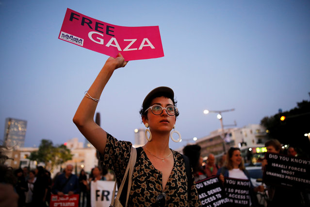 A protester holds a placard as she takes part in a demonstration calling for an end to Israel's policy towards Gaza and a boycott of the 2019 Eurovision Song Contest as the first semi final of the contest begins in Tel Aviv, Israel May 14, 2019. (Photo by Corinna Kern/Reuters)