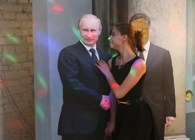 "A woman poses with a cut-out of Vladimir Putin in the ""President Cafe"" in Krasnoyarsk, Siberia, Russia, April 7, 2016. (Photo by Ilya Naymushin/Reuters)"
