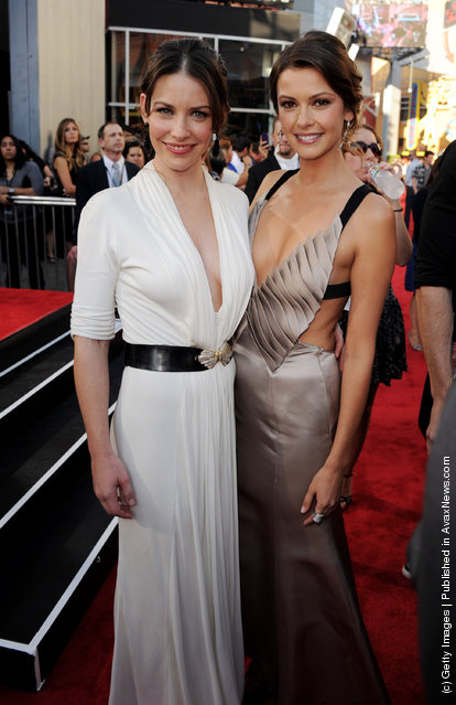 Actors Evangeline Lilly (L) and Olga Fonda arrive at the premiere of DreamWorks Pictures' Real Steel